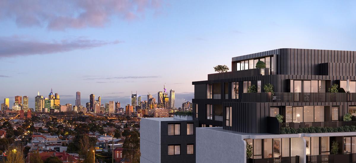 B.E. Apartments exterior with city skyline